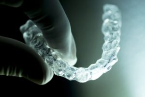A Man holding Aligners