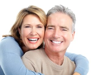 Dentures with full-mouth dental implants