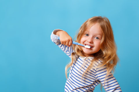 Small Girl Brushing Teeth